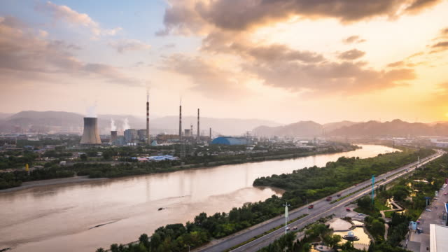 refinery and power plant near river Huang He in lanzhou at sunset timelapse video