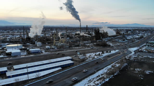 Refinery Drone View Footage at Dusk Drone view footage of an oil refinery at dusk gas pipe stock videos & royalty-free footage