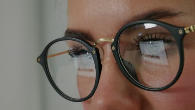 Reflection at the glasses of young woman: looking a site Reflection at the glasses of young woman: looking a site (side view) Beautiful girl works on internet close up web browser stock videos & royalty-free footage