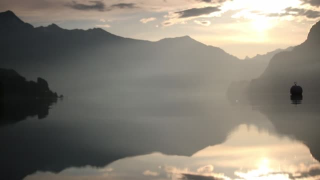 Reflection in mountain lake at sunrise video