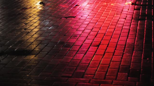 reflection of colored lights on the pavement at night. shine cobbled neon reflection of colored lights on the pavement at night. shine cobbled neon street alley stock videos & royalty-free footage
