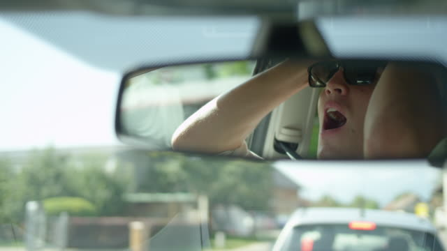 slow motion: reflection of frustrated young man yelling at car in front of him. - ingorgo stradale video stock e b–roll