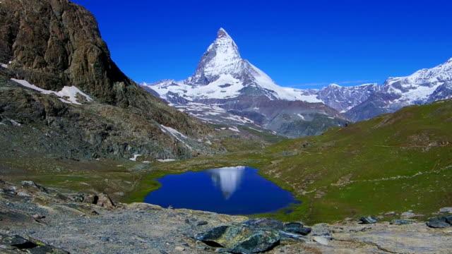 stockvideo's en b-roll-footage met reflection of the matterhorn in zermatt, switzerland - matterhorn