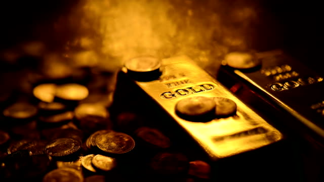 LOOPABLE: Reflections on gold Changing reflections on gold bars and coins. All objects are very clean, scratch and dust free. The footage is loopable with smooth transition.  gold bars stock videos & royalty-free footage