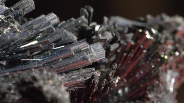 MACRO DOF Reflective black semi precious stone casting off strong rays of light video