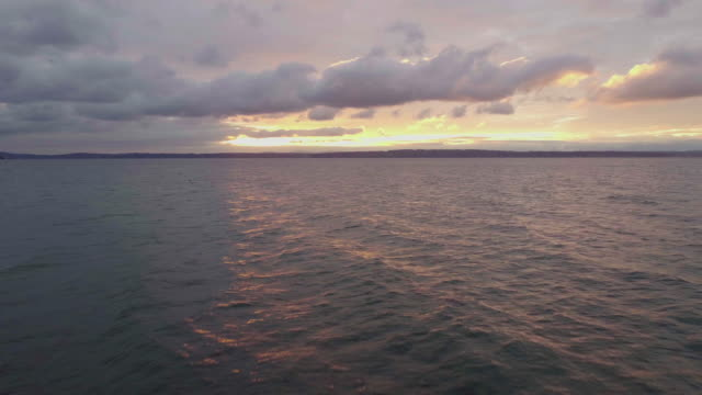 Reflective Water With Moody Colorful Romantic Sky video