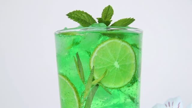 refreshing summer mojito cocktail lemonade ice, tarragon, lime, mint, bubbles move in a glass