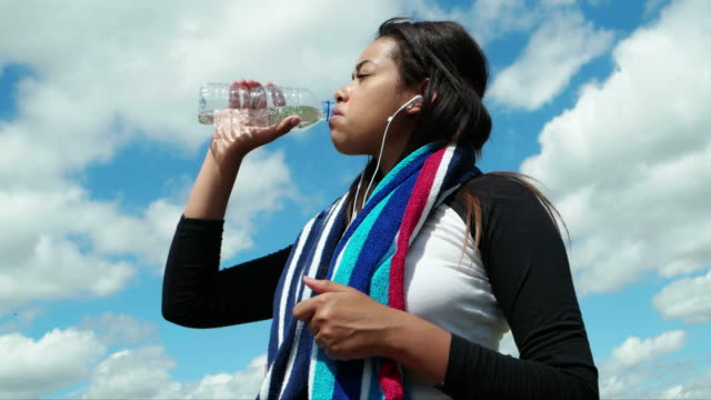 Refreshing water. Drinking from a bottle. video