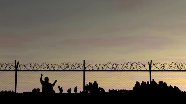 refugee camp behind barbed wire. - голодный стоковые видео и кадры b-roll