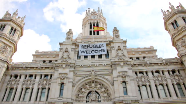 Refugee welcome flag on the facade of Palacio de comunicaciones in Madrid video