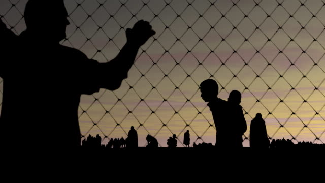 Refugees. Migrants behind barbed wire. Refugees. Migrants behind barbed wire. Refugees seeking asylum time zone stock videos & royalty-free footage