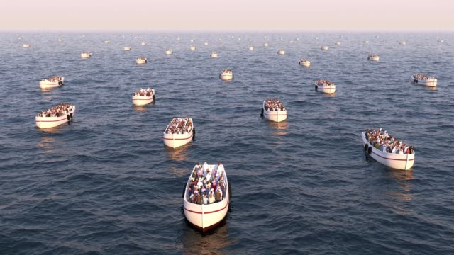refugees on boats floating on the sea - fuggitivo video stock e b–roll