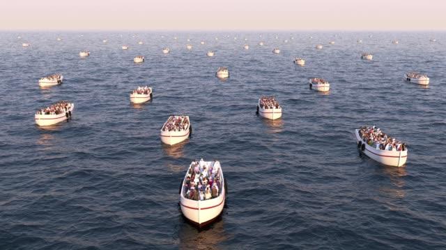 refugees on boats floating on the sea - погружённый стоковые видео и кадры b-roll