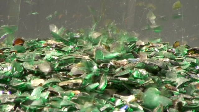 Refuse series - green cullet dropping onto a heap video