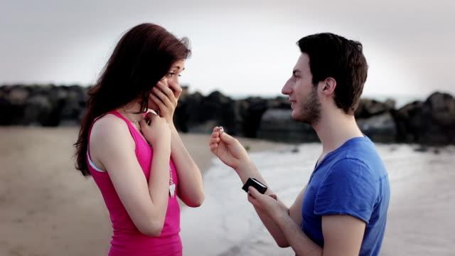 regain a woman - man gives a ring to a woman - kiss video