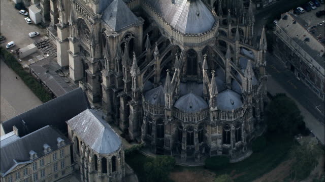 reims cathedral  - aerial view - champagne-ardenne, marne, arrondissement de reims, france - cathedrals stock videos & royalty-free footage