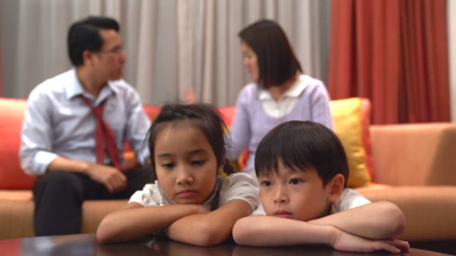 Relationship problems. Frustrated couple having an argument with each other.Portrait of a sad son and a daughter bored or tired of parents fighting, frustrated little boy and girl upset of mom dad shouting, a preschool child looking at camera feeling lack