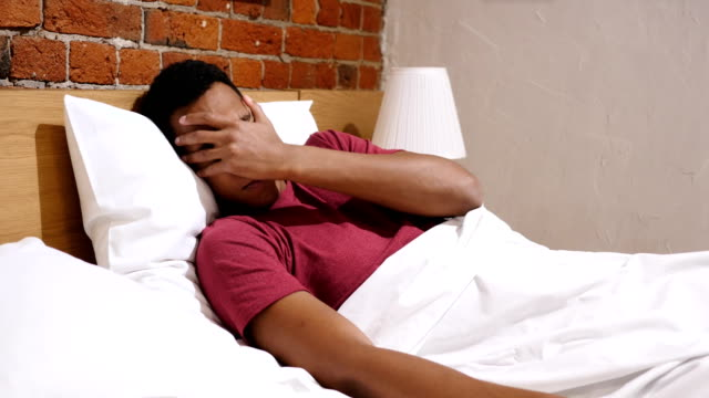 Relaxed African Man Awakes from Sleep in Morning video