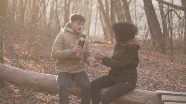 Relaxed couple drinking tea from thermos video