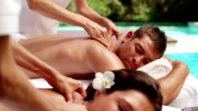 Relaxed couple having massage Relaxed couple having massage in a sunny day massage stock videos & royalty-free footage