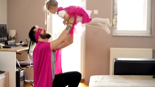 vídeos de stock e filmes b-roll de relaxed parenting - super hero