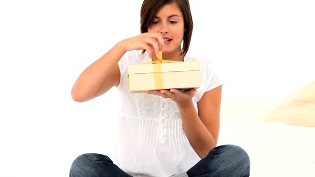 Relaxed woman opening a gift video