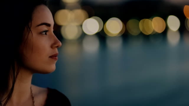 Relaxed woman, summer night feeling, she on a bridge video