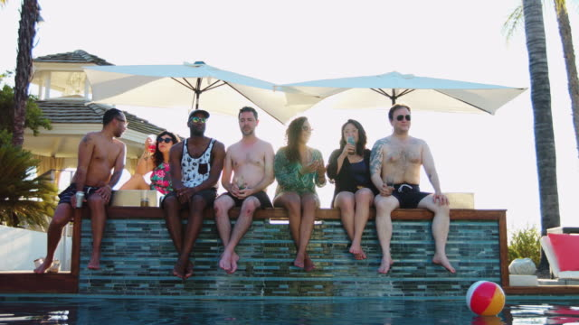 Relaxing at Pool Party on Edge of Hot Tub video