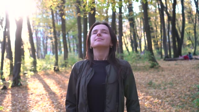 Relaxing breath in the autumn park. Steady shot. Slow motion