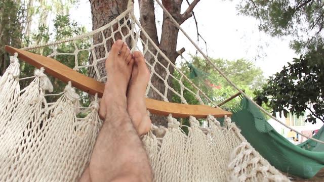 relaxing in a hammock - pedicure filmów i materiałów b-roll