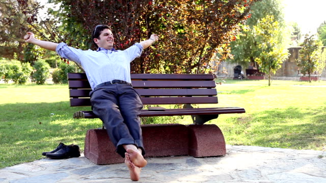 Relaxing on park bench after a hard day's work video