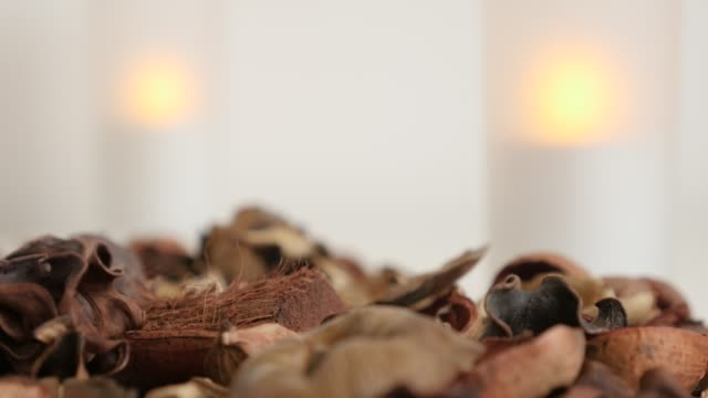 Relaxing scene with flowers and spices of potpourri mixture  - Zen background of candles and fragrant dried petals
