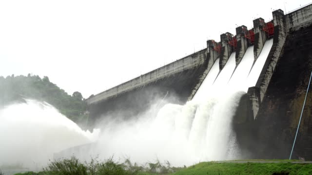 release of water at a dam wall. - energia rinnovabile video stock e b–roll