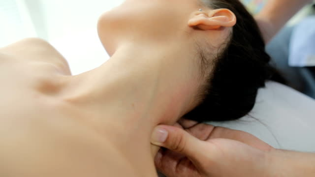 Releasing all the tension Young woman enjoying in a neck massage at the spa neck stock videos & royalty-free footage