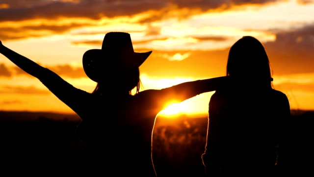 Releasing stress 27 years old cowgirls are going to take a walk near the ranch. They want to enjoy the sunset cowgirl stock videos & royalty-free footage