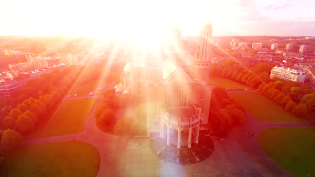 Religion symbol, bright light from church, Love and God symbol, aerial fly over, worship and sacrifice. Bright light resembles hope and religious blessing, catholic temple building means faith video