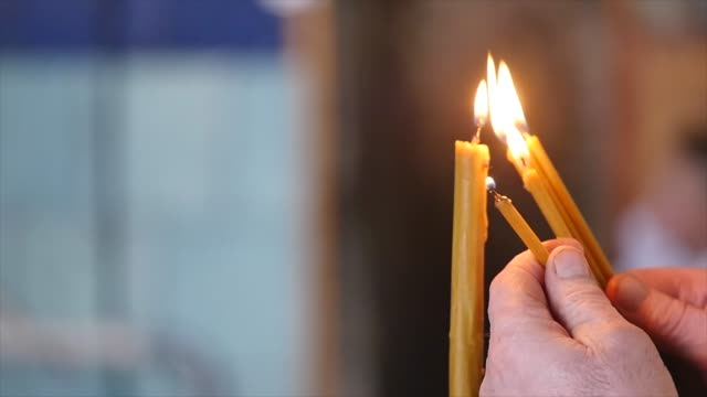 Religious candles burning in church video