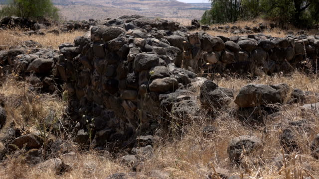 Remains of Ancient City Wall in Barren Field video