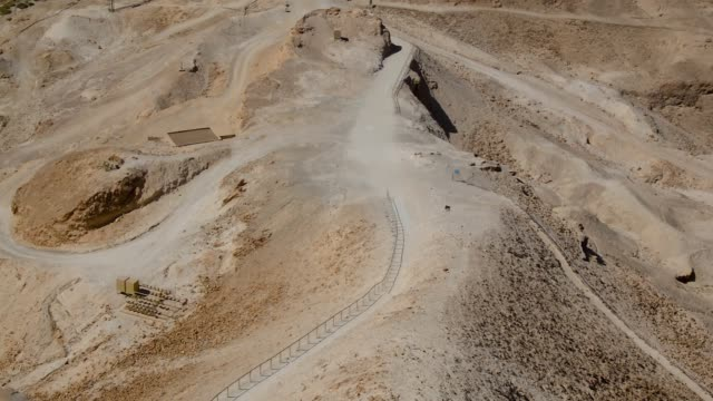 Remains of old Roman fortification in Masada National Park in Israel. Remains of old Roman ramp made for attack in Masada National Park in Israel. archaeology stock videos & royalty-free footage
