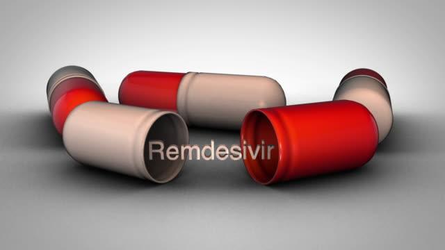 Remdesivir pills - rotation 3D graphic animation on a white background remdesivir stock videos & royalty-free footage