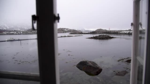 remote coastal fishing cabin on lofoten archipelago in norway - arcipelago video stock e b–roll