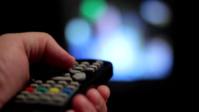 remote control man changing tv channels start button stock videos & royalty-free footage