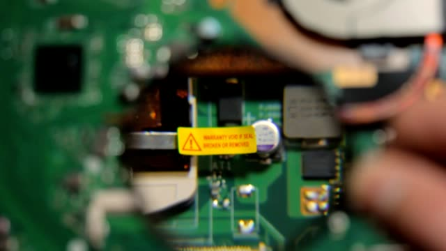 Remove the warranty seal from the laptop motherboard video