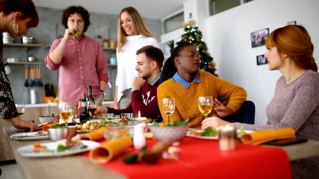 removing dishes from the dining table - christmas table video stock e b–roll
