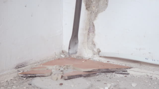Removing tiles with jackhammer video