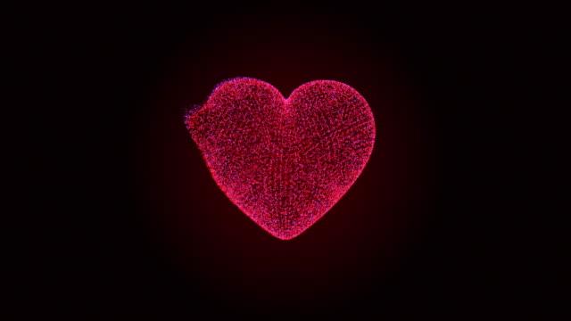 暗い背景に浮かぶ流体を持つ 3D レンダリングの心臓パーティクル ビデオ