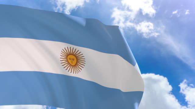 Render 3D de bandera Argentina ondeando sobre fondo de cielo azul con canal alfa - vídeo