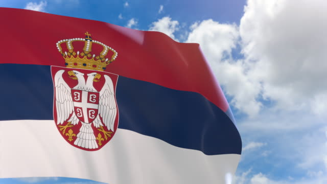 3D rendering of Serbia flag waving on blue sky background with Alpha channel video