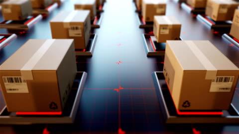 vidéos et rushes de 4 paquets de rendu 3d de k sont transportés dans les milieux de haute technologie, achats en ligne, la notion de gestion de logistique automatique. - marchandise