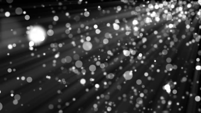 3D rendering silver particles shimmer and create bokeh on a black background. Computer generated abstract background